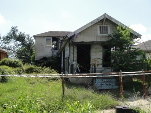 A damaged house abandoned after Katrina, still vacant 5 years later.