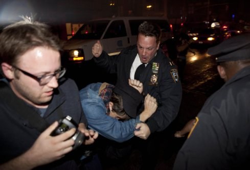 Police beat OWS protestor