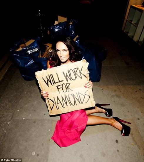 Tamara Ecclestone holding a cardboard sign